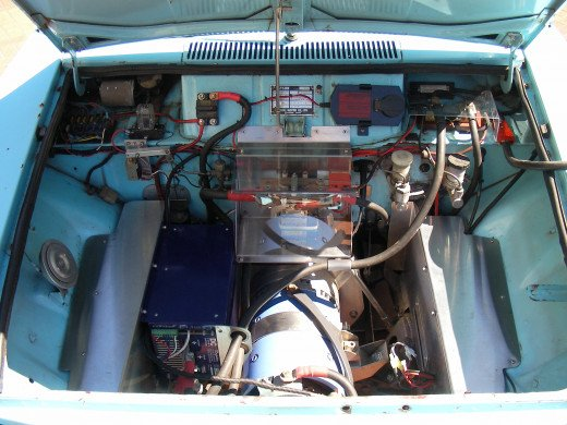 Under the hood of a converted Datsun pickup.