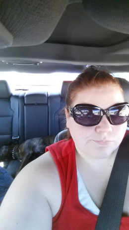 Me and my (not working) Service Animal in one of our rental cars.