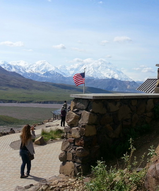 At the Eilson Visitors center, still over 40 miles from Denali as the proverbial crow flies, the wind-whipped US flag pays homage to the power of nature.