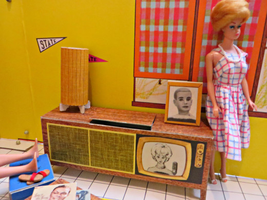 Fashion Queen Barbie is styling and profiling next to her console television with built in stereo turntable. She has a photo of her main man on the console along with her cool Eames Era Lamp.