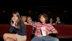 Oops! This guy was busted doing one of the things a teen boy should never do with his date at the movies.