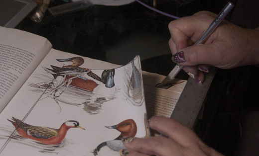 Cutting the pages with Exacto knife.