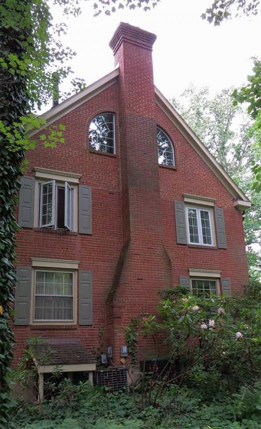 Masonry (brick) chimney stack.