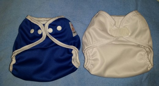 Kawaii diaper covers, blue snap closure closed at size small vs. white velcro closure closed at size small