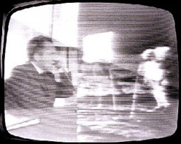 A split screen showing President Nixon on Earth talking to Niel Armstong and Buzz Aldrin on The Moon.