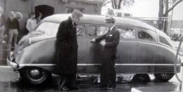 Stout (L) shows off his automotive design