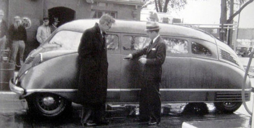 Stout (L) shows off his automotive design