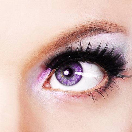 Pretty purple eyes naturally occur because of a lack of pigment, but are very rare.