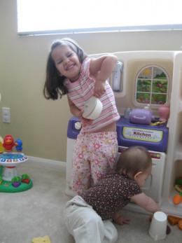 My babies enjoying their toy kitchen.