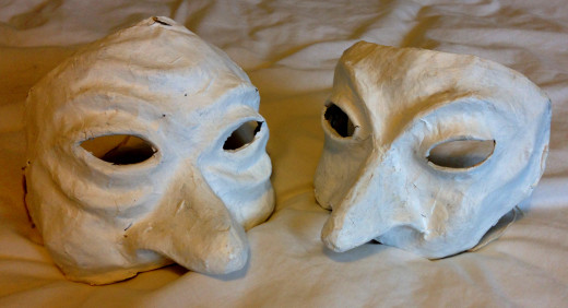 Two half-masks, made with papier mache from clay moulds