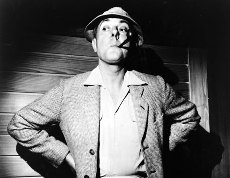 "Jacques Tati as his character ""M. Hulot."" Note the  enlarged nose at this camera angle. The large nose and nostril is a hallmark of some French cartooning."