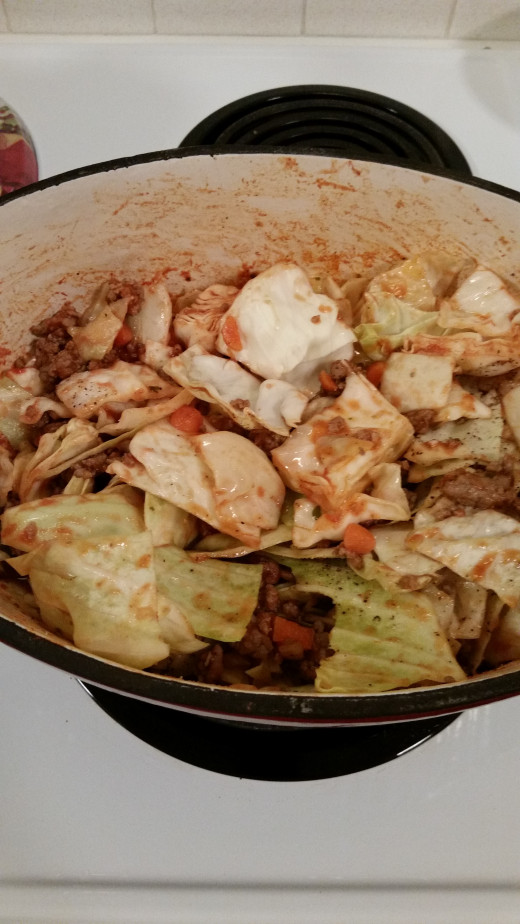 Add in the cabbage, tomato sauce, brown sugar, and bay leaf. Cover and let simmer until the cabbage in tender. It should be ready by the time your rice is done.