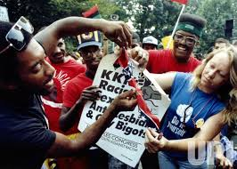 Demonstrators protesting a Ku Klux Klan march in Washington burn a Confederate flag prior to the event 9/2/1990.