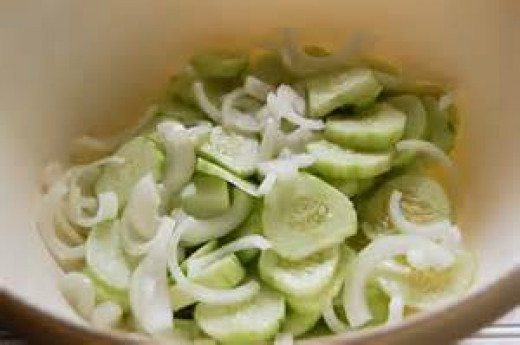 Slice cucumbers and onions