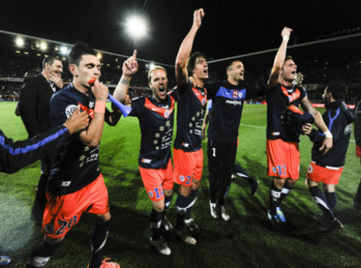 Montpellier players celebrate in Auxerre, France after their club won 2-1 in its season finale in Ligue One. The victory gave Montpellier its first ever Ligue One title as it amassed 82 points for the season.