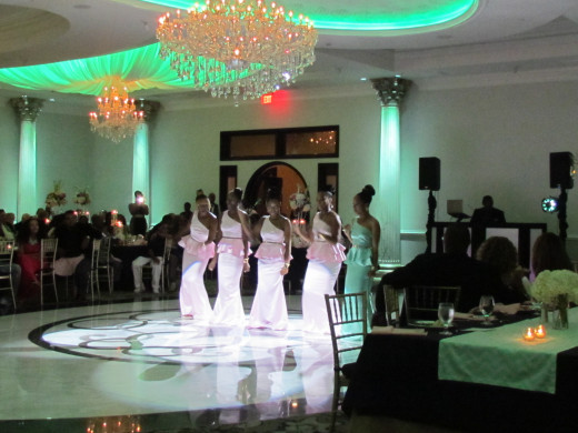 The bridesmaids perform their line dance for the couple.