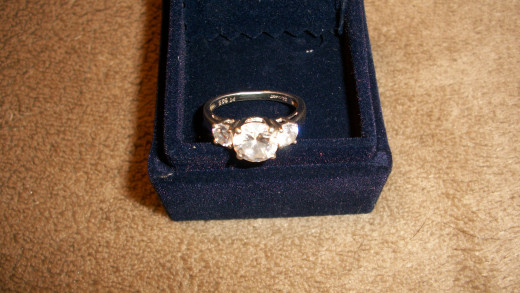 A very pretty wedding ring, as a token of love for the bride.