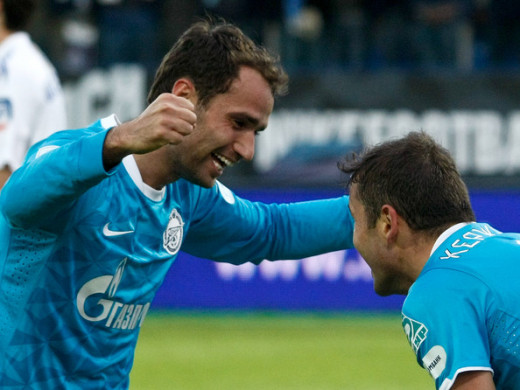 Roman Shirokov goes in to congratulate Alexander Kerzhakov after the latter scored a goal in a Russian Premier League match against CSKA Moscow. Zenit won the Russian Premier League title in 2012.