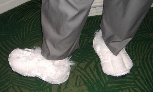 Rabbit feet spats over sneakers