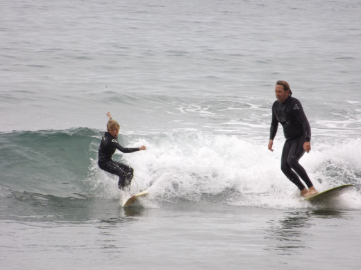 Surfing with the next generation, (son) Forest and his father Larry, Santa Barbara, California
