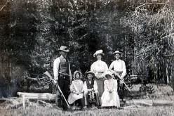 A family settling a parcel of land and hunts for game at the same time.