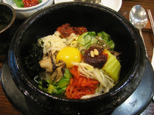 A colorful and flavorful mix of ingredients for a bowl of bibimbap. Yummy!