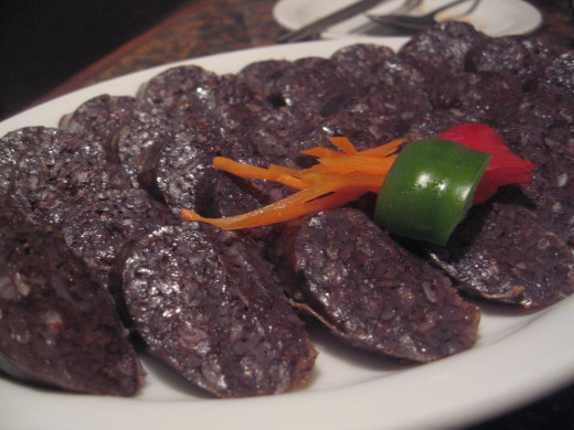 Try a bite of this Korean blood sausage. A delicious treat with sundae.