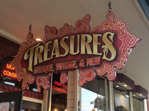 The sign for Treasures antique shop.