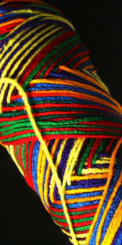 Multi-colored yarns entertain children and create eye catching garments.