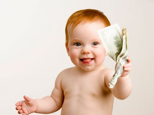 A baby holding money