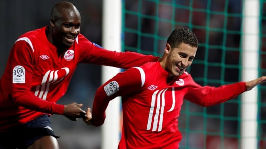 Moussa Sow (L) and Eden Hazard (R) celebrate during a match against Brest in Ligue 1. Sow finished as the league's top goalscorer, while Hazard finished as France's Player of the Year in 2011.