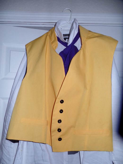 Vest with collared shirt and necktie