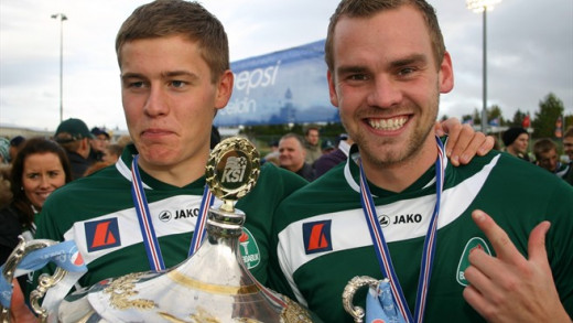 Alfred Finbogasson (L) celebrates with captain Karl Ársælsson after Breiðablik won the league title with a scoreless draw against Starjnan. The title was the first for a Kopavogur-based club in Iceland.
