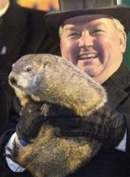 n this Feb. 2, 2003, file photo, Punxsutawney Phil is raised by handler Bill Deeley in Punxsutawney, Pa. The groundhog did not see his shadow Friday which, according to German folklore, means folks can expect an early spring instead of six more weeks