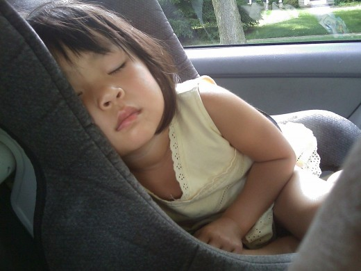 Sleeping child cozy inside a car