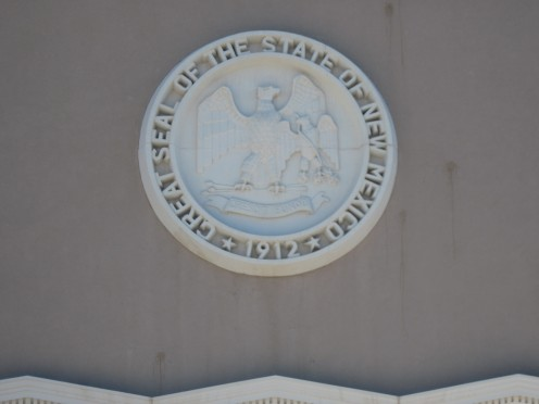 Seal on top of entrance to New Mexico State Capitol Building.