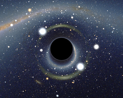 The ratio between the black hole Schwarzschild radius and the observer distance to it is 1:9. Of note is the gravitational lensing effect known as an Einstein ring.