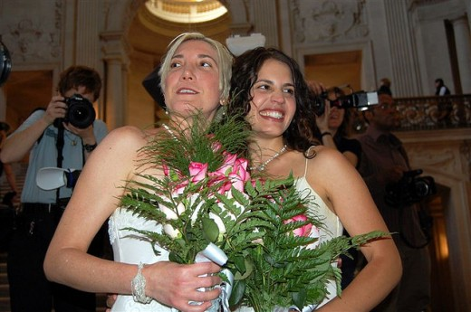 Same-sex marriage of a woman to another woman.