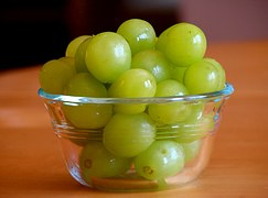 A bowl of fresh grapes has lots of vitamin C in them.