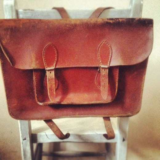 This is called a book satchel. I carried one similar to this in my early schooling years.