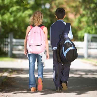 Couples wear backpacks.