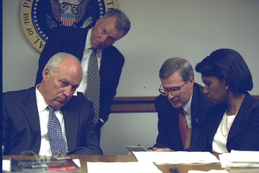 Shocked stupor: Cheney sat with Condoleezza Rice and others burning the midnight oil.