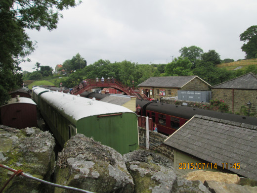 Goathland's station looking from the north across the up platform (trains to Pickering) past the green liveried camping coaches