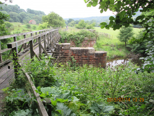 Bridge piers on the original W&PR route, the decking removed long ago for use elsewhere and replaced recently by the National Park Authority as part of the walk route between Grosmont and Goathland