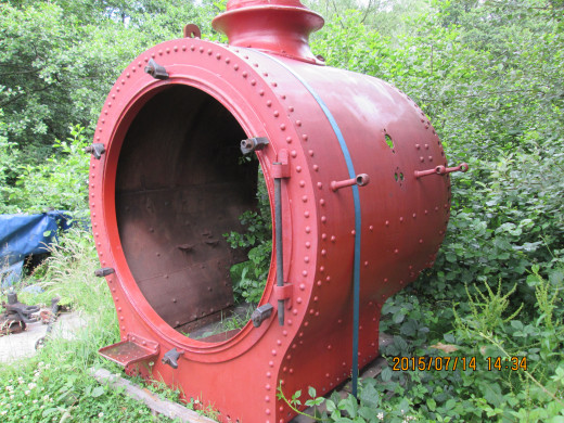 Smokebox minus door awaits use at the back of the shed. Handrail guides protrude from the sides - painted in oxide red as protection from rust