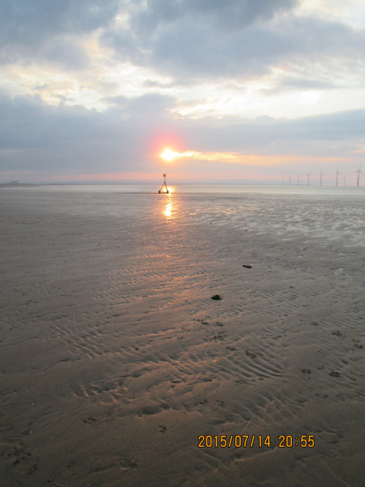 Sun setting over the Tees Bay - there are three rows of wind turbines off Redcar beach now, linked to the National Grid - the lion's share of electricity generation will be by power stations into the foreseeable future
