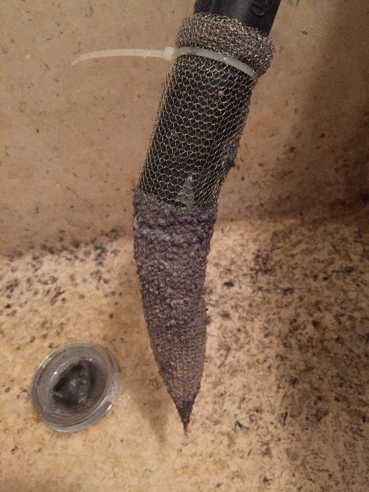This is a full lint trap that needs to be changed.  This is the gunk that you are keeping out of your septic system and sticking to the sides of your plumbing