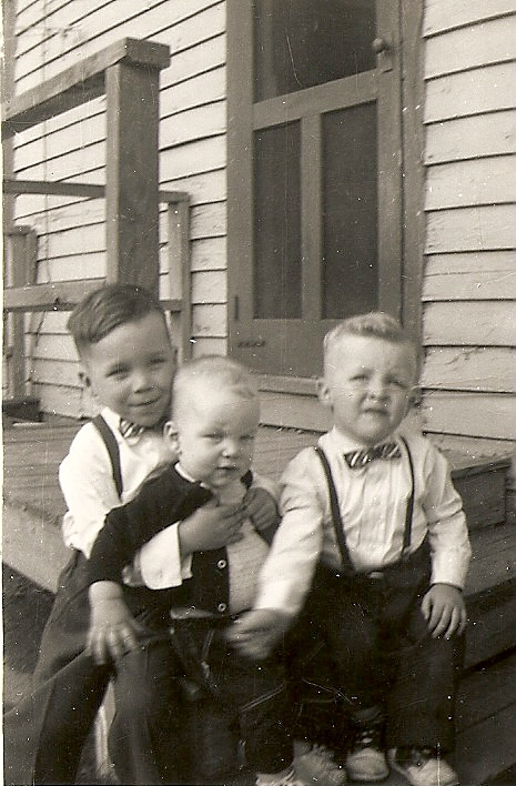 On the left are my two brothers, Gill and Phillip.  My mother sacrificed and bought us some new clothes for Easter church service.  I was showing her my cuff links.