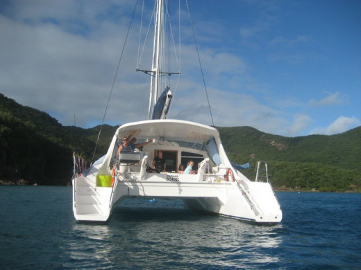The 'sugar scoop' sterns and shallow draft means that you can get very close to the reef and beaches, An inflatable dinghy with and outboard is attached via pulleys between the stern hulls.