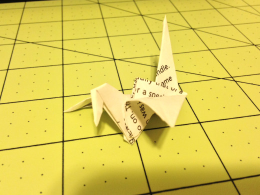 These are the cranes that flap. If you pinch under the head and pull the tail up and back the wings will flap. Don't pull too hard or you will rip it. Now you just have to make 999 more.